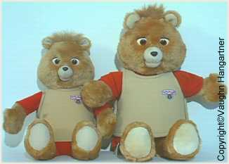 This is a picture showing the size comparison between the Original Teddy Ruxpin's and the late WOW/Playskool version. -Image-